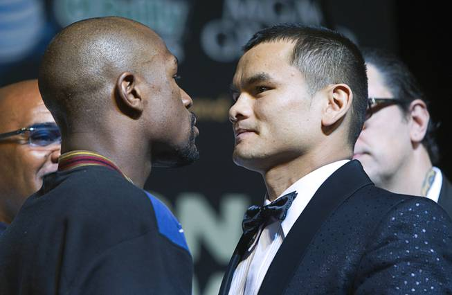 WBC welterweight champion Floyd Mayweather Jr. and WBA champion Marcos Maidana of Argentina face off during a news conference at MGM Grand on Wednesday, April 30, 2014. The two champions will meet in a WBC/WBA unification fight at MGM Grand Garden Arena on Saturday.