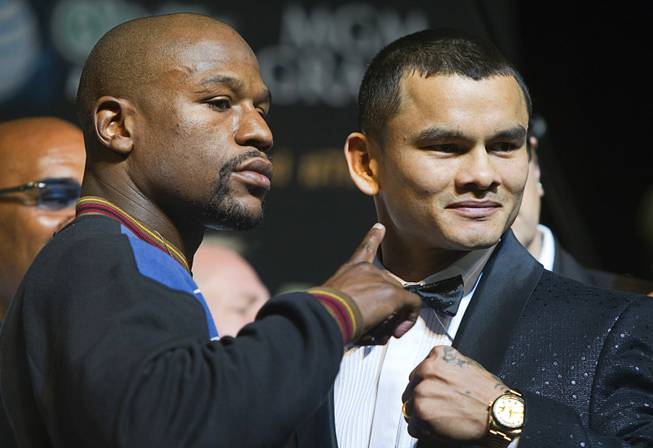 WBC welterweight champion Floyd Mayweather Jr. and WBA champion Marcos Maidana of Argentina attend a news conference at MGM Grand on Wednesday, April 30, 2014. The two champions will meet in a WBC/WBA unification fight at MGM Grand Garden Arena on Saturday.