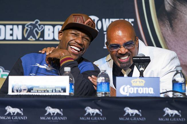 WBC welterweight champion Floyd Mayweather Jr. (L) laughs with Mayweather Promotions CEO Leonard Ellerbe during a news conference at the MGM Grand Wednesday, April 30, 2014. Mayweather will take on WBA welterweight champion Marcos Maidana of Argentina in a WBC/WBA unification fight at the MGM Grand Garden Arena on Saturday.