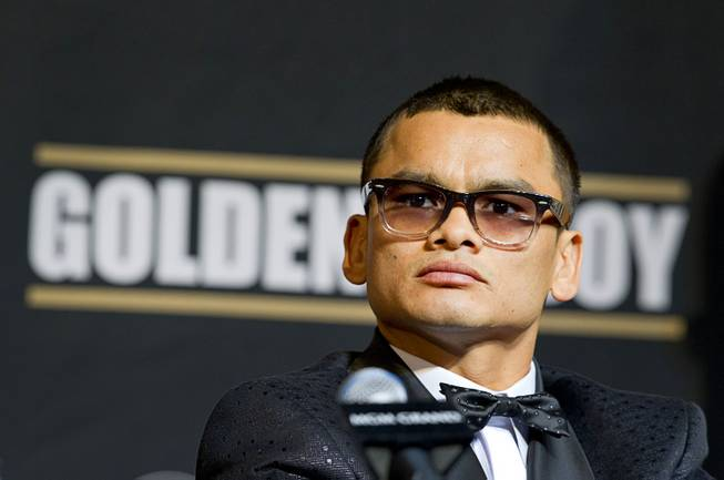 WBA welterweight champion Marcos Maidana of Argentina attends a news conference at the MGM Grand Wednesday, April 30, 2014. Maidana will challenge WBC welterweight champion Floyd Mayweather Jr. in a WBC/WBA unification fight at the MGM Grand Garden Arena on Saturday.