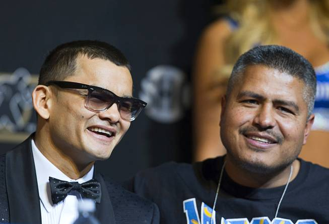 WBA welterweight champion Marcos Maidana, left, of Argentina attends a news conference with trainer Robert Garcia at the MGM Grand on Wednesday, April 30, 2014. Maidana will challenge WBC welterweight champion Floyd Mayweather Jr. in a WBC/WBA unification fight at the MGM Grand Garden Arena on Saturday.