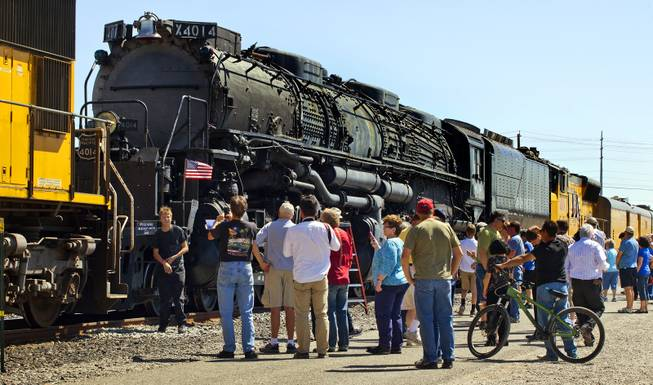 Visitors view the Big Boy No. 4014 steam locomotive on a stop at Union Pacific Railroad in Las Vegas on its way to Cheyenne, Wyoming, on Wednesday, April 30, 2014.  It will to be restored at the Union Pacific Heritage Steam Fleet Operations  there over the next five years.