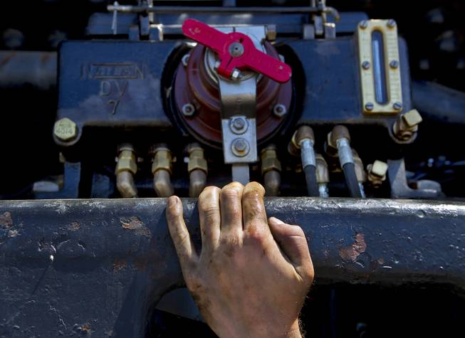 Austin Barker with heritage operations for the Union Pacific Railroad, continues maintenance on the mechanical lubricator beneath the Big Boy No. 4014 steam locomotive stopped at the Union Pacific Railroad in Las Vegas on Wednesday, April 30, 2014.