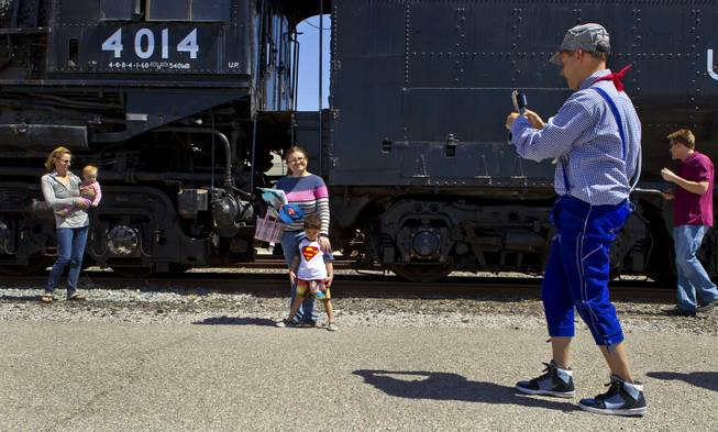 Visitors enjoy seeing the Big Boy No. 4014 steam locomotive on a stop at Union Pacific Railroad in Las Vegas on its way to Cheyenne, Wyoming, on Wednesday, April 30, 2014.  It will to be restored at the Union Pacific Heritage Steam Fleet Operations  there over the next five years.