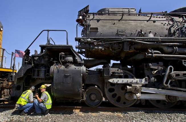 Ed Dickens, senior manager of heritage operations for the Union Pacific Railroad, confers with team member Austin Barker about the Big Boy No. 4014 steam locomotive stopped at the Union Pacific Railroad in Las Vegas on Wednesday, April 30, 2014.