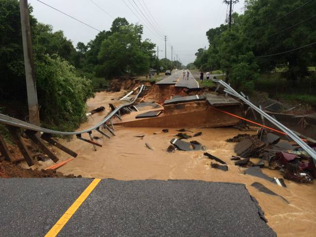 In this image provided by Brantly S. Keiek shows a section of the Scenic Highway that collapsed due to heavy rain in Pensacola, Fla., Thursday, April 30, 2014.