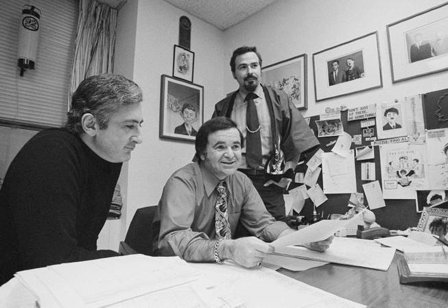 "In this 1972 file photo, ""Mad"" magazine Editor Al Feldstein, center, sits with Art Director John Putnam, left, and a freelancer named Jack, at the magazine's New York headquarters. Feldstein, whose 28 years at the helm of Mad transformed the satirical magazine into a pop culture institution, died Tuesday, April 29, 2014. He was 88."