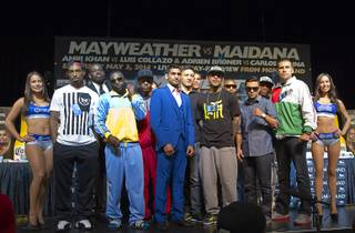 Undercard boxers pose during a news conference at the MGM Grand Thursday, May 1, 2014. The boxers will fight on the Mayweather vs. Maidana undercard at the MGM Grand Garden Arena on Saturday.