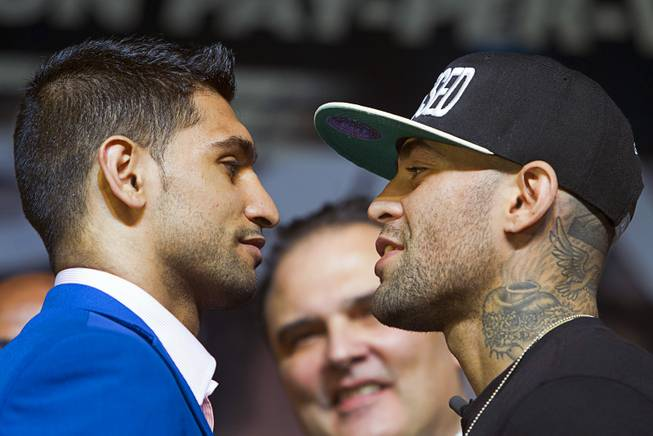 Welterweight boxers Amir Khan, left, of Britain and Luis Collazo during a news conference for undercard boxers at the MGM Grand Thursday, May 1, 2014. The boxers will fight at the MGM Grand Garden Arena on Saturday.