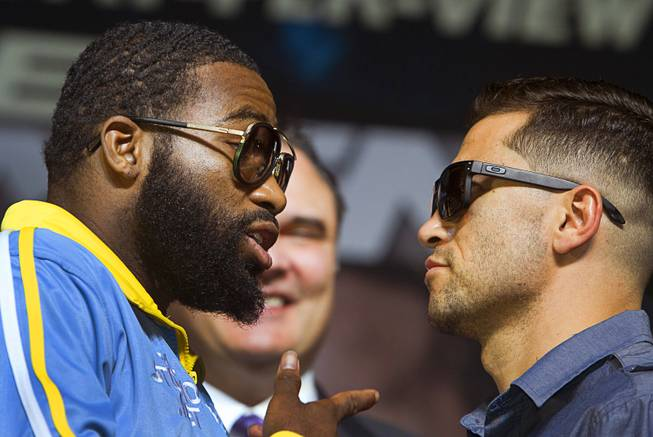 Super lightweight boxer Adrien Broner left  speaks with opponent Carlos Molina as they face off during a news conference for undercard boxers at the MGM Grand Thursday, May 1, 2014. The boxers will fight at the MGM Grand Garden Arena on Saturday.