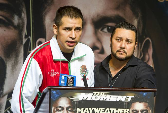 Super middleweight boxer Marcos Periban, left, of Mexico speaks at a news conference for undercard boxers at the MGM Grand Thursday, May 1, 2014. Periban will fight J'Leon Love at the MGM Grand Garden Arena on Saturday.