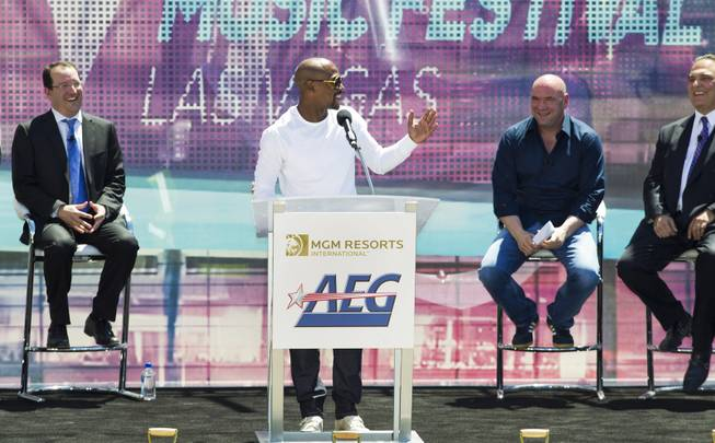 Undefeated boxing champion Floyd Mayweather Jr., gets the crowd laughing during his speech at the AEG and MGM Resorts International ground breaking VIP/media event on Thursday, May 1, 2014.