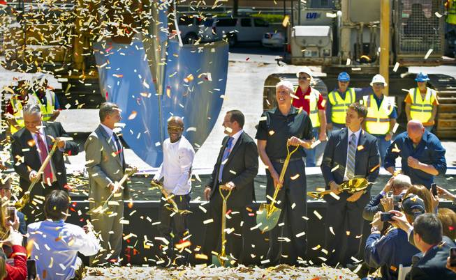 Steve Sisolak, Clark County commissioner; Jim Murren, Chairman and CEO of MGM Resorts International; boxer Floyd Mayweather Jr.; Dan Beckerman, president and CEO of AEG; Bill Walton, sportscaster and former NBA player; Luke Robitaille, president, business operations for the Los Angeles Kings; and Dana White, president of UFC, break ground on a new indoor arena on Thursday, May 1, 2014, in Las Vegas. The 20,000-seat sports and entertainment venue will be located near New York-New York and Monte Carlo and adjacent to I-15.