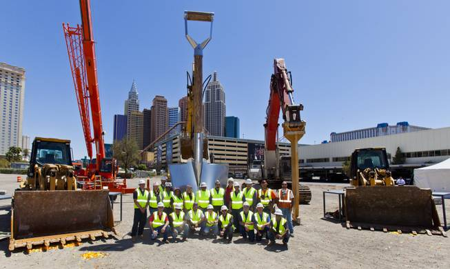 Members of Thor Construction pose before a giant shovel following the AEG and MGM Resorts International ground breaking for a new world-class indoor arena in Las Vegas on Thursday, May 1, 2014.  The 20,000-seat sports and entertainment venue will be located near the heart of the famed Las Vegas Strip and adjacent to the I-15 corridor.