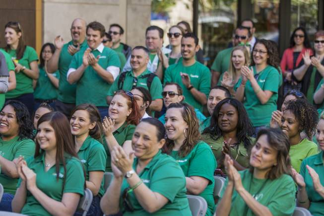 SolarCity employees clap during the company's Nevada expansion celebration press conference at Town Square Thursday, May 1, 2014. 
