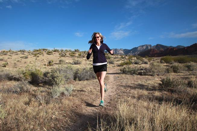 Ultramarathon runner Molly Sheridan runs cross country on a trail at Red Rock National Conservation Area Wednesday, April 23, 2014.