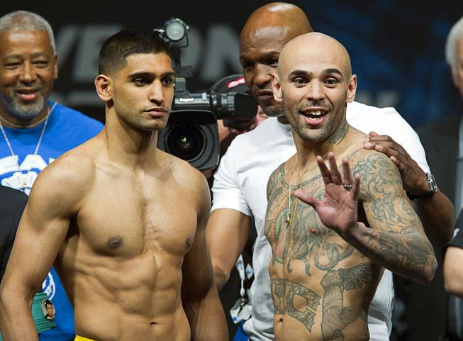 Amir Khan, left, of Britain and Luis Collazo  pose during an official weigh-in at the MGM Grand Garden Arena Friday, May 2, 2014. The boxers will meet for a welterweight fight at the arena on Saturday.
