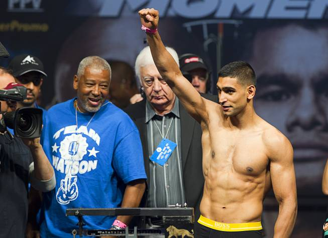 Amir Khan of Britain acknowledges fans during an official weigh-in at the MGM Grand Garden Arena Friday, May 2, 2014. Khan will face Luis Collazo  for a welterweight fight at the arena on Saturday.