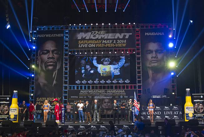 WBA welterweight champion Marcos Maidana of Argentina is shown on a video screen as he arrives for an official weigh-in at the MGM Grand Garden Arena Friday, May 2, 2014. Maidana faces WBC welterweight champion Floyd Mayweather Jr.  in a WBC/WBA unification fight at the arena on Saturday.
