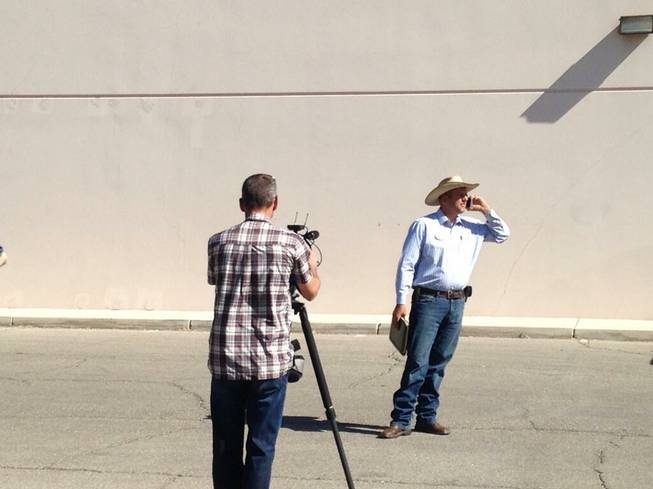Ammon Bundy, Cliven Bundy's son, prepares a press conference in front of the Metro Police station on Friday, May 2.