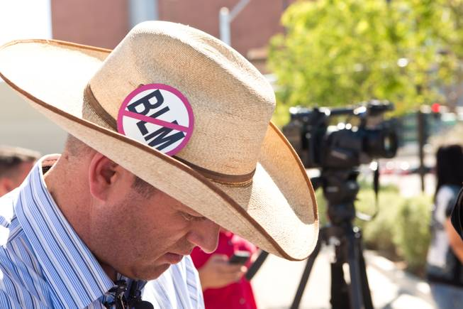Ammon Bundy, son Cliven Bundy, prepares to speak with the media during a peaceful protest in front of the Metro Police department, Friday May 2, 2014.