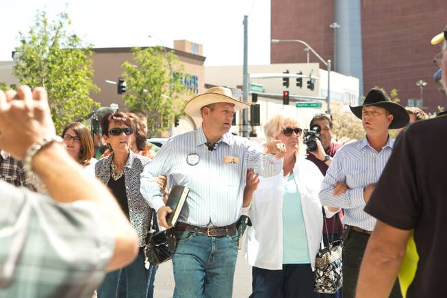 Ammon Bundy, along with family members and supporters, prepare to speak with the media during a peaceful protest in front of the Metro Police department, Friday May 2, 2014.
