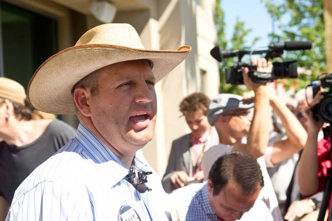 Ammon Bundy, son of Cliven Bundy, speaks to the media during a peaceful protest in front of the Metro Police department, Friday May 2, 2014.