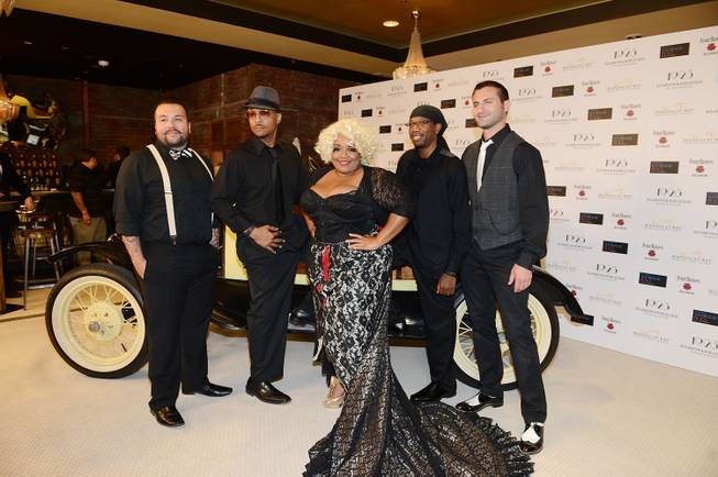 Skye Dee Miles and her men arrive at the grand opening of 1923 Bourbon & Burlesque by Holly Madison at Mandalay Bay on Thursday, May 1, 2014, in Las Vegas.