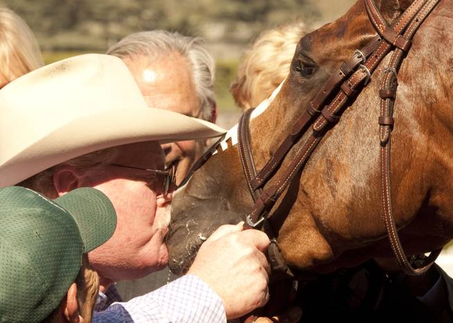 In this image provided by Benoit Photo, co-owner Steve Coburn has a big kiss for his California Chrome following his wire-to-wire for victory in the San Felipe Stakes horse race Saturday, March 8, 2014, at Santa Anita Park in Arcadia, Calif.