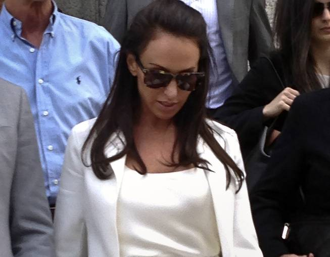 Molly Bloom leaves federal court after receiving probation for a guilty plea, Friday, May 2, 2014 in New York.