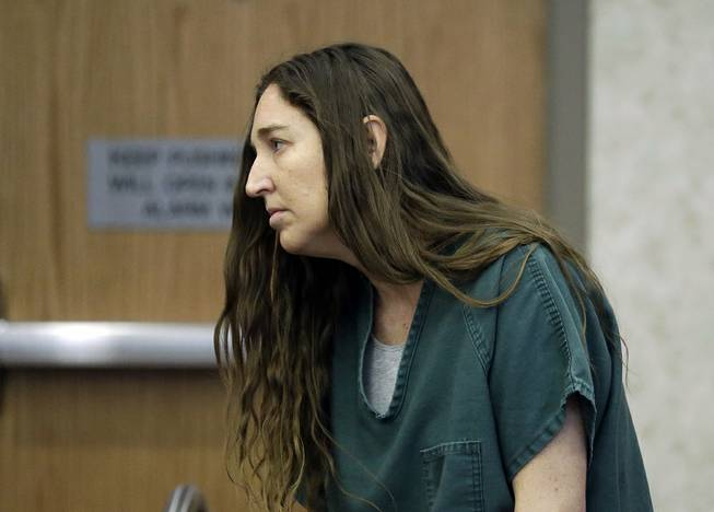 Megan Huntsman, accused of killing six of her babies and storing their bodies in her garage, appears in court Monday, April 28, 2014, in Provo, Utah.