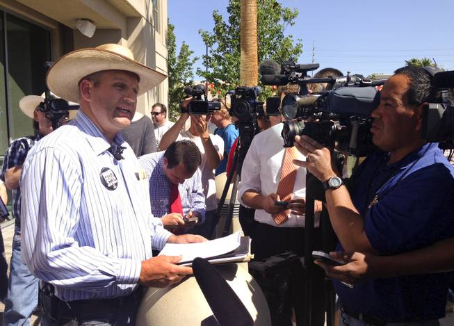 Ammon Bundy, one of Cliven Bundy's sons, talks to the media during a rally held by the Bundy family at Metro headquarters Friday, May 2, 2014.