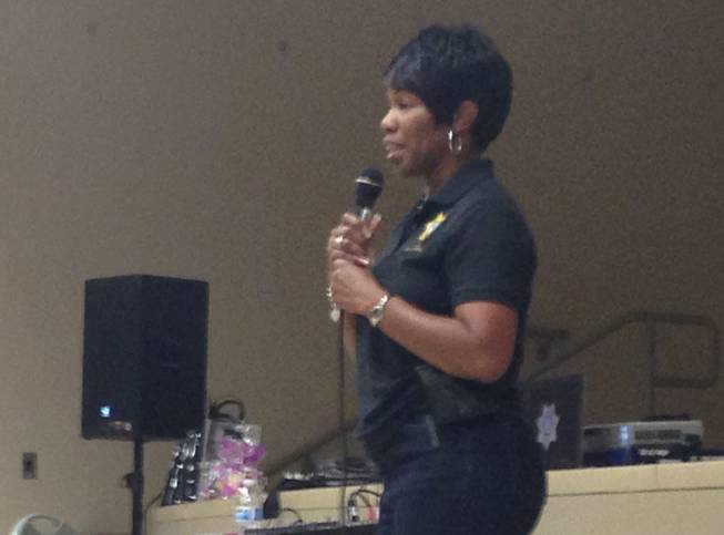 "Event organizer Regina Coward speaks Saturday, May 3, 2014, during the Metro Police co-sponsored ""Choose Purity"" event at the William Pearson Center in North Las Vegas."
