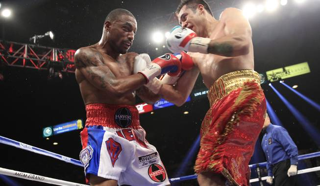 J'Leon Love, left, of the U.S. battles it out with Marco Antonio Periban of Mexico during their super middleweight fight at the MGM Grand Garden Arena on Saturday, May 3, 2014.