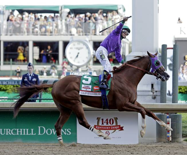 Victor Espinoza rides California Chrome to a victory during the 140th running of the Kentucky Derby horse race at Churchill Downs on Saturday, May 3, 2014, in Louisville, Ky.