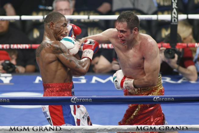 J'Leon Love, left, of the U.S. takes a punch from Marco Antonio Periban of Mexico during their super middleweight fight at the MGM Grand Garden Arena on Saturday, May 3, 2014.