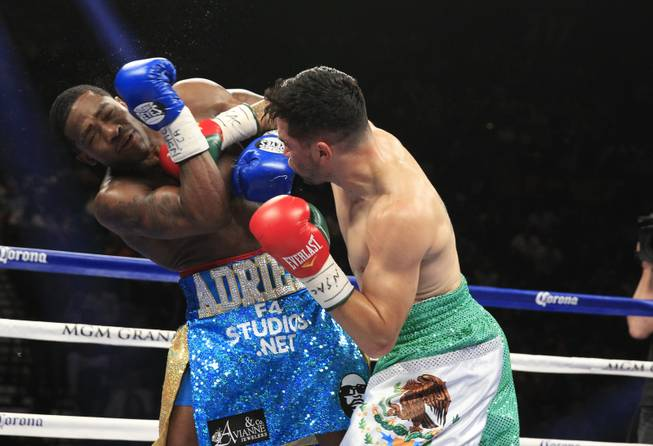 Adrien Broner of the U.S. takes a hit from Carlos Molina, also of the U.S., during their super lightweight fight at the MGM Grand Garden Arena on Saturday, May 3, 2014.