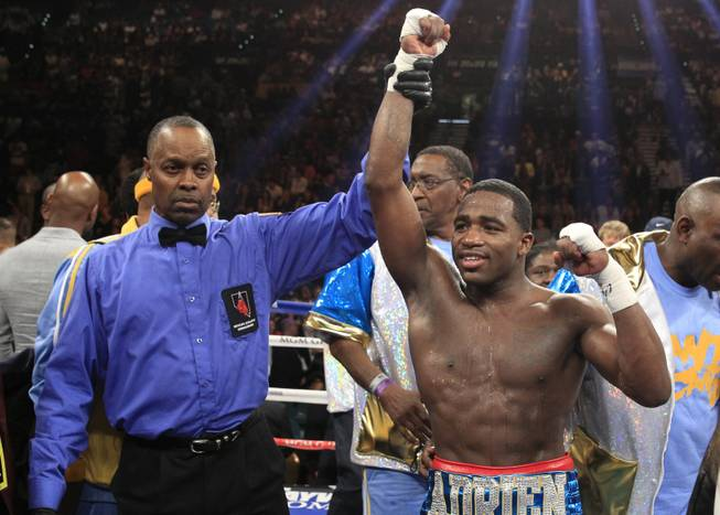 Adrien Broner of the U.S. celebrates his victory over Carlos Molina in their super lightweight fight at the MGM Grand Garden Arena on Saturday, May 3, 2014. Boxing Referee Kenny Bayless is at left.