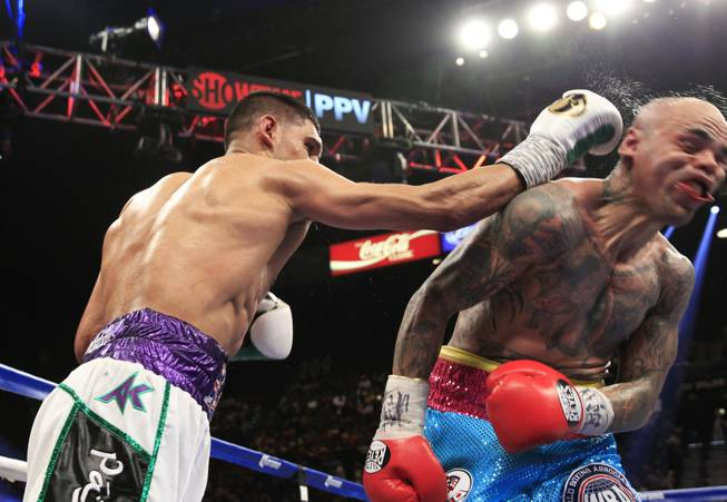 Amir Khan of Britain connects on Luis Collazo of the U.S. during their welterweight fight at the MGM Grand Garden Arena on Saturday, May 3, 2014.