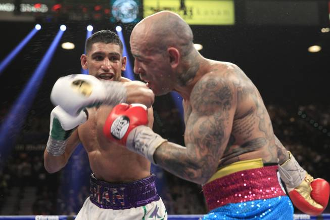 Amir Khan, left, of Britain punches at Luis Collazo of the U.S. during their welterweight fight at the MGM Grand Garden Arena on Saturday, May 3, 2014.
