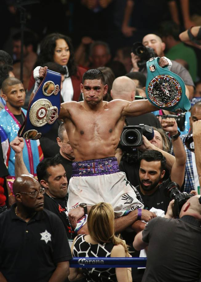 Amir Khan of Britain celebrates his victory over Luis Collazo of the U.S. during their welterweight fight at the MGM Grand Garden Arena on Saturday, May 3, 2014.