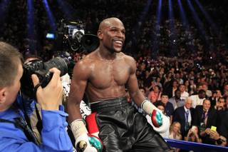 Floyd Mayweather Jr. of the U.S. celebrates his victory over Marcos Maidana of Argentina during their WBC/WBA welterweight unification fight at the MGM Grand Garden Arena on Saturday, May 3, 2014. Mayweather improved his record to 46-0.