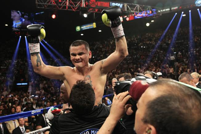 Marcos Maidana of Argentina celebrates after a WBC/WBA welterweight unification fight against Floyd Mayweather Jr. of the U.S. at the MGM Grand Garden Arena on Saturday, May 3, 2014.