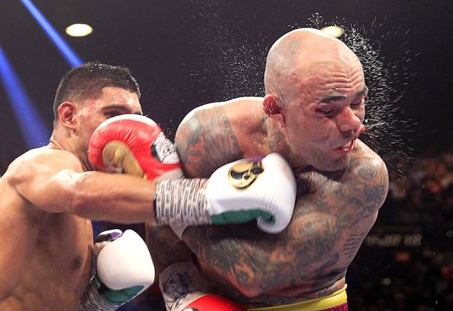 Luis Collazo (R) of the U.S. takes a punch from Amir Khan of Britain during their welterweight fight at the MGM Grand Garden Arena Saturday, May 3, 2014.