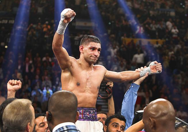 Amir Khan of Britain celebrates his victory over Luis Collazo after their welterweight fight at the MGM Grand Garden Arena Saturday, May 3, 2014.