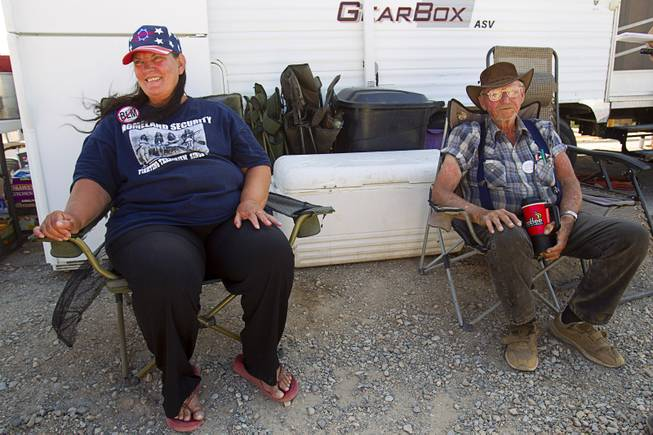 Bevalyn Marshall, a cousin of rancher Cliven Bundy, and Jesse Halsell of Northern California, relax at a supporter rally point near Bunkerville, Sunday, May 4, 2014.