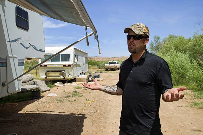 Ryan Payne, militia liaison, responds to a question during an interview at the Bundy Ranch near Bunkerville, Sunday, May 4, 2014.