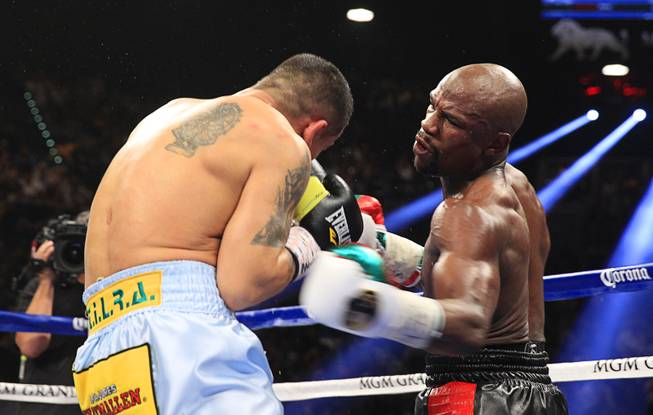 Marcos Maidana, left, of Argentina fights Floyd Mayweather Jr. of the U.S. during their WBC/WBA welterweight unification fight at the MGM Grand Garden Arena on Saturday, May 3, 2014.