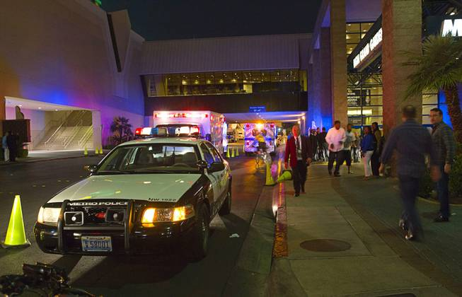 Metro Police cars and ambulances are shown outside the MGM Grand Garden Arena after a crush of fans caused a series of injuries following the Floyd Mayweather Jr. vs. Marcos Maidana title fight at the MGM Grand on Saturday night, May 3, 2014.