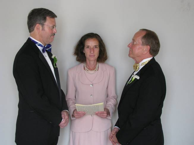 In this photo released by the Episcopal Dioceses of New Hampshire, Mark Andrew, left, and Bishop V. Gene Robinson are shown during their private civil union ceremony performed by Ronna Wise in Concord, N.H., on June 7, 2008. Robinson, the first openly gay Episcopal bishop, announced Saturday, May 3, 2014, he is getting divorced from Andrew.